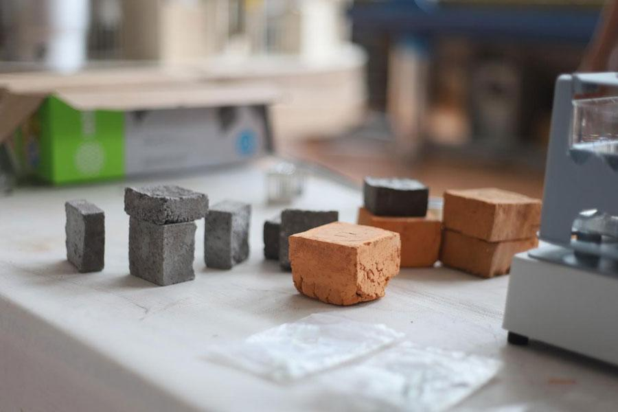 Researchers study clay bricks that attenuate radiation at the Sealing Materials Plant in the Nizhny Novgorod Region, Russia