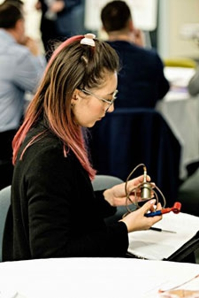 An attendee at a ClayTech session